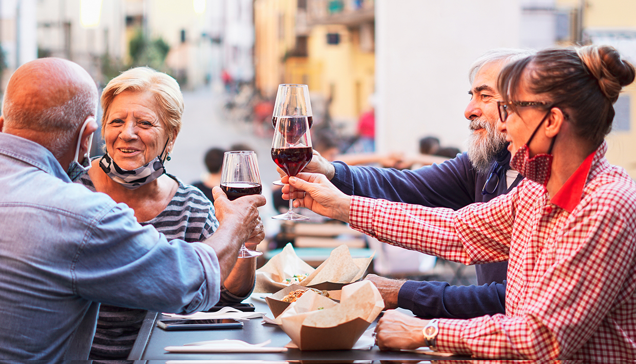 Group of old people eating and drinking outdoor – Doubble date w