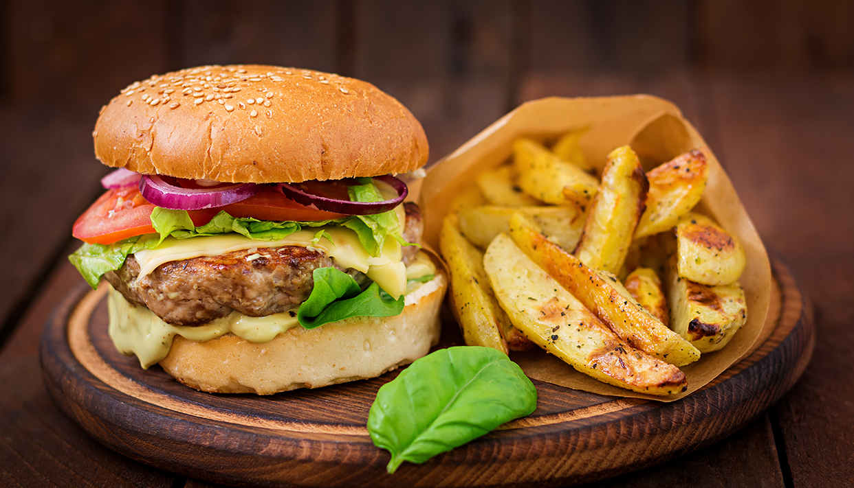 Big sandwich – hamburger with juicy beef burger, cheese, tomato,