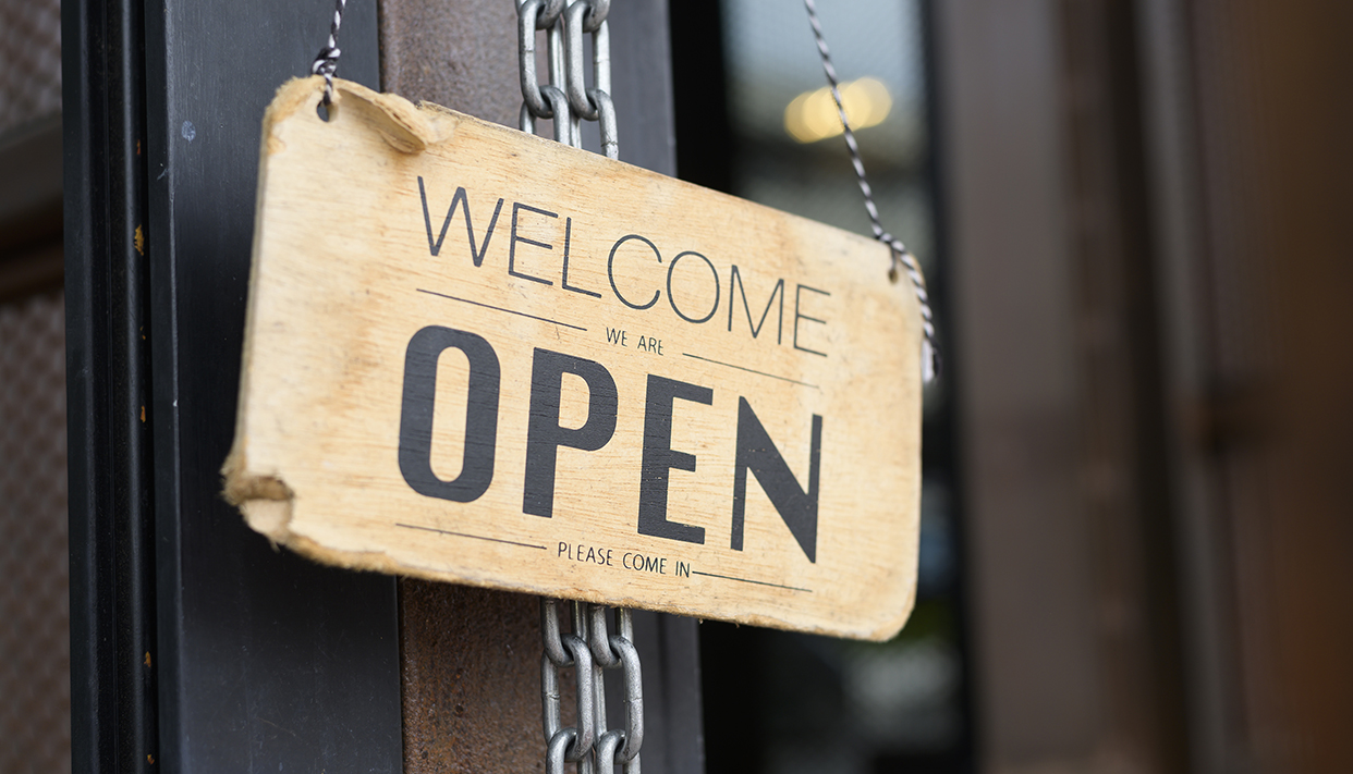 Open sign in coffee shop door , business reopen After Covid-19 outbreak concept