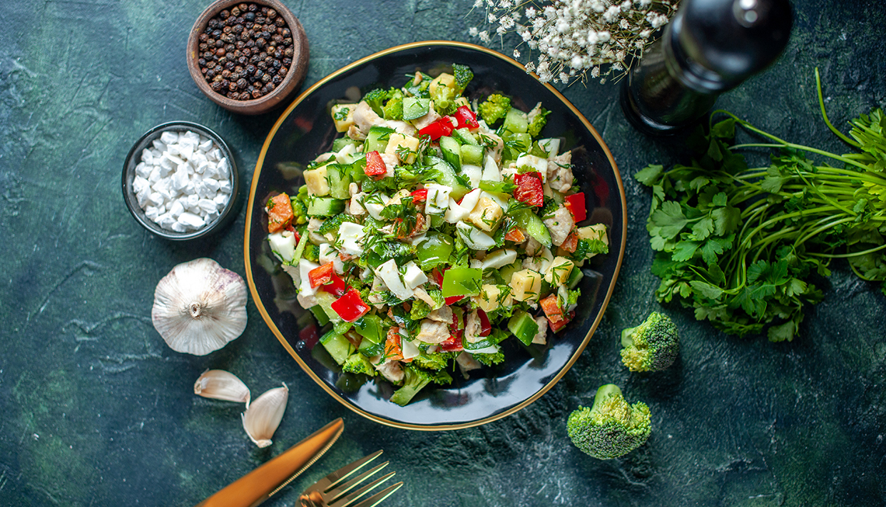 top view vegetable salad consists of cucumber cheese and tomatoe