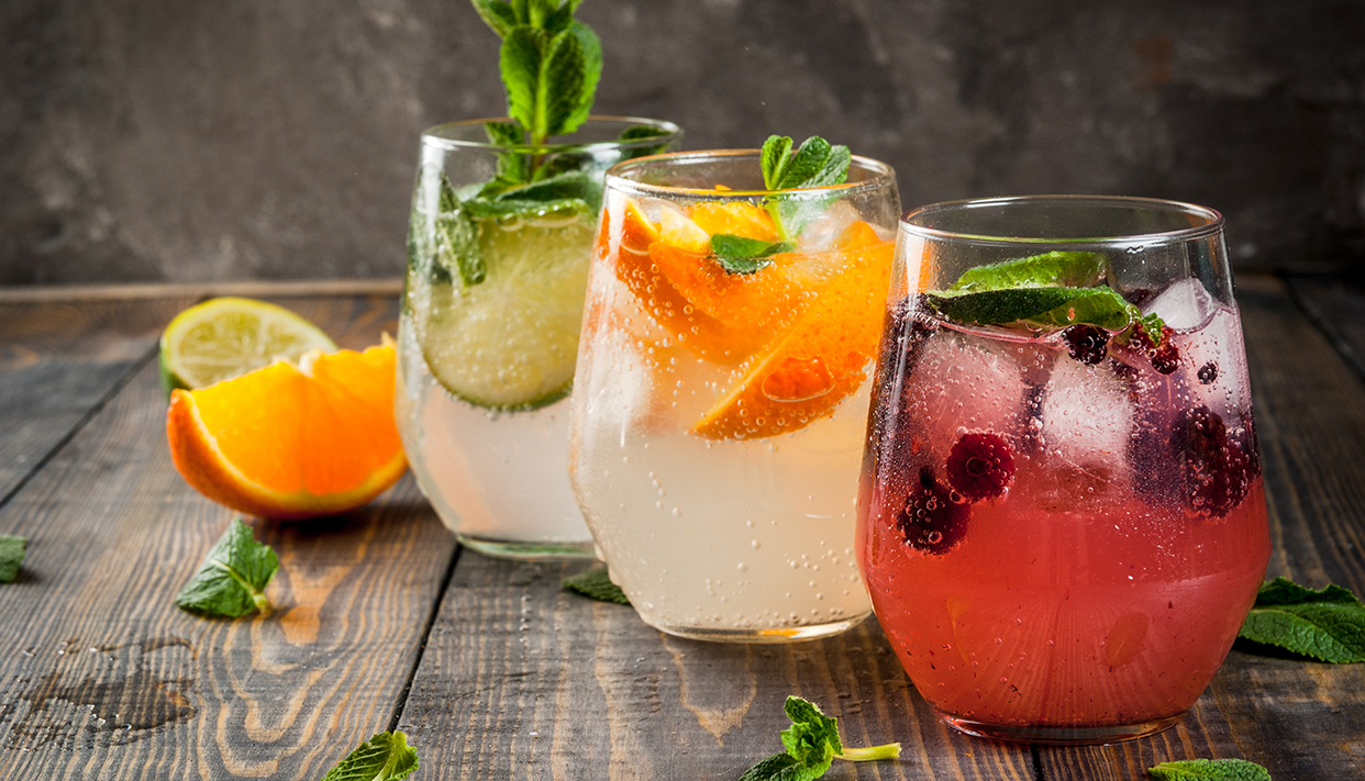 Selection of three kinds of gin tonic: with blackberries, with o