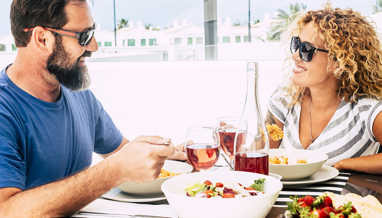 Happy mature adult caucasian couple enjoy lunch together i outdo